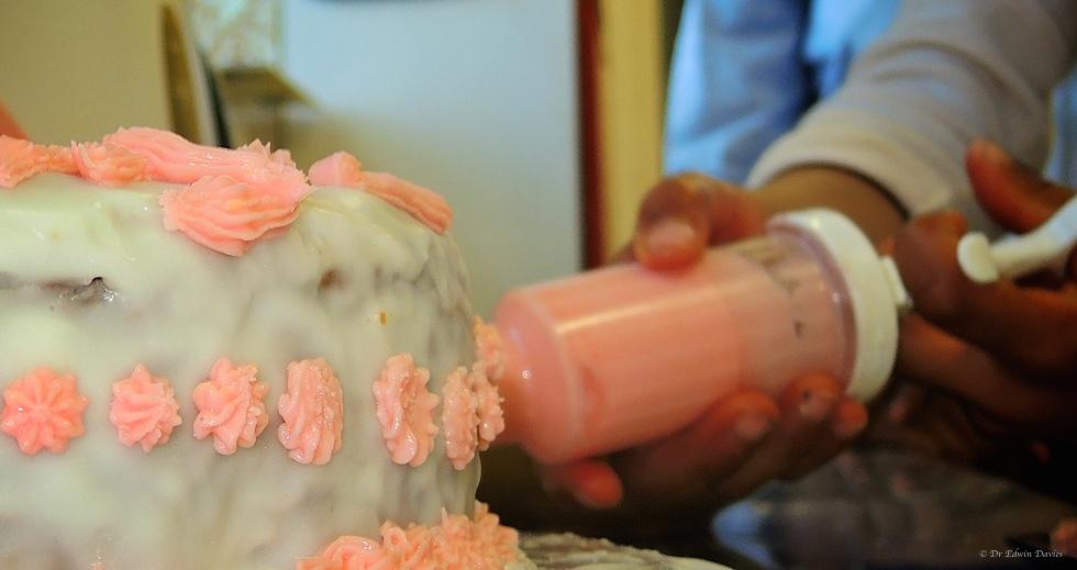 Icing a birthday cake