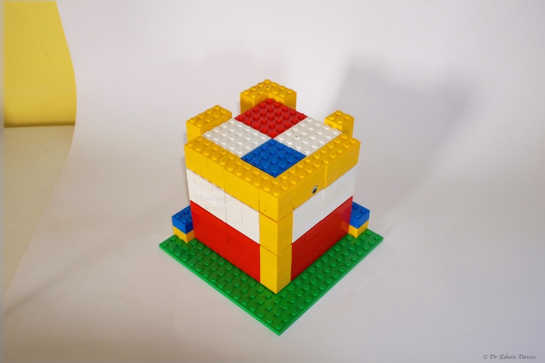 lego trinomial cube holder with 'a' 'b' and 'c' layers