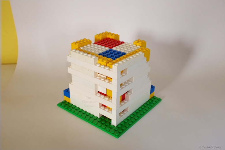 lego trinomial cube holder with hinged, removable gate