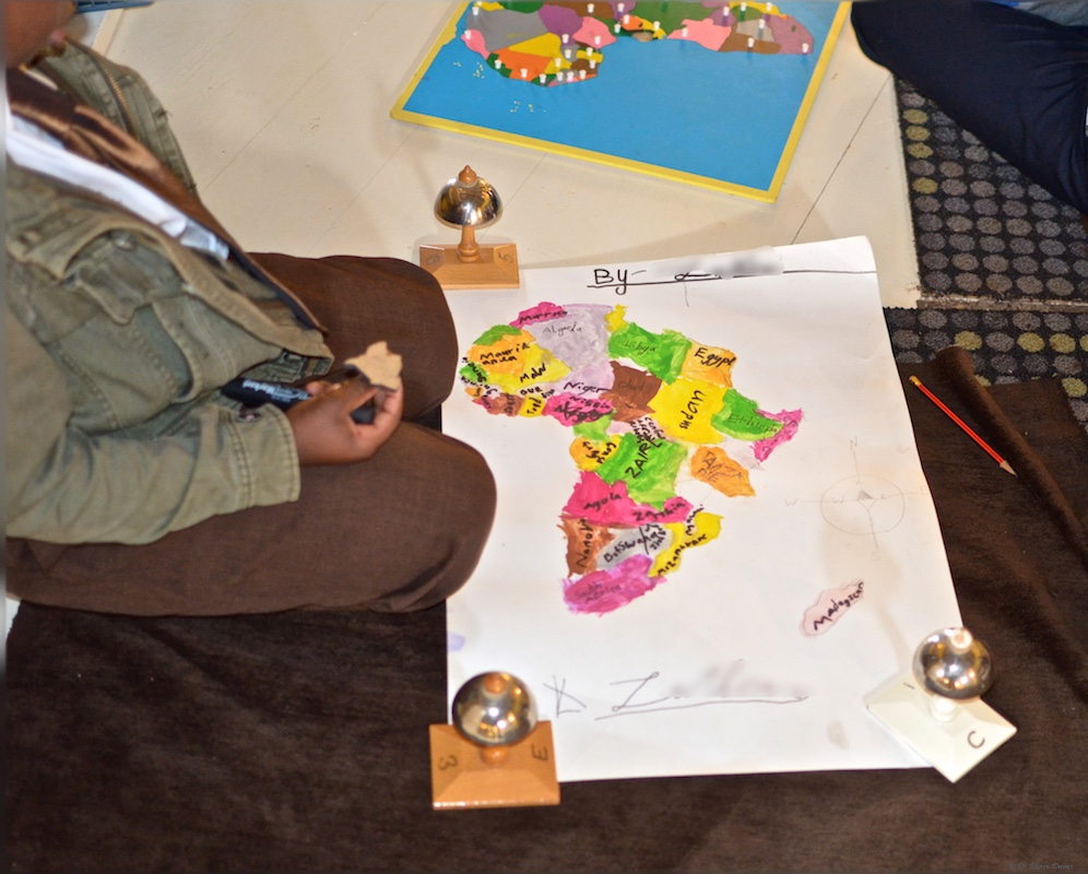 7 year old student with his own map of Africa
