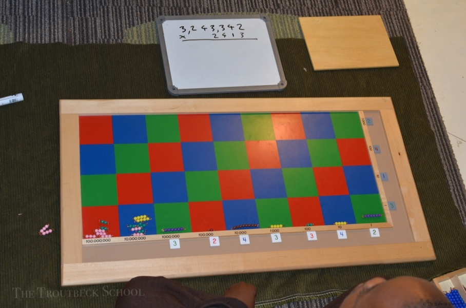 4 digit multiplication using the Montessori checker board
